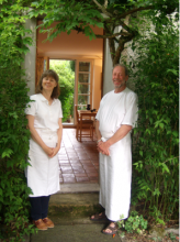 Janet and Pablo Loerkens welcoming guests to their table d'hôte near Lausanne, Switzerland.